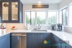 Double bunkbed room is on entry floor next to bathroom and downstairs queen room.