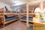 First floor full bathroom with tub and shower. Located next to bunkbed room and queen bedroom.
