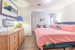 Laundry room with washer, dryer, small ironing board, iron and mud sink.