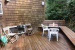 Back Deck with table and plenty of seating. Gas and Coal BBQ.