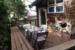 Plenty of seating on the back deck which now has a gas bbq and coal bbq.
