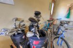 Garage with one adult bike and two teen bikes.