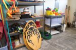 The garage has a lot of amenities for renters use including beach toys.