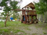 Play set right outside front of cabin