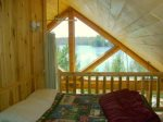 Second bedroom in loft is also open to main living area and beautiful view of lake
