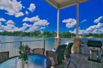 Main level balcony with propane grill, patio table and chairs