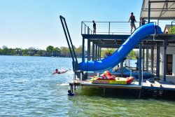 The Strand High-End Family Friendly Resort, Infinity Edge Heated Swimming Pool with Spill-Over Hot Tub, Massive Boat Dock with Tunnel Waterslide and Rope Swing