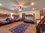 Four Twin Over Full Bunk Beds, 48 in Wall Mounted TV w/ Satellite, Pool Table, Game Table