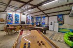 The Barn - air conditioned game room with pool table, shuffleboard, multi-cade, tv
