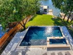 Infinity Edge Swimming Pool with Spill-Over Hot Tub pool can be heated for an additional fee
