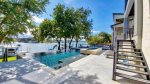Take in stunning Lake LBJ views from your opulent Lakeshore Retreat