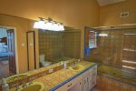 MASTER BATHROOM WITH TUB / SHOWER COMBO AND DOUBLE VANITY upstairs