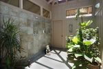 Kohala and Kona downstairs suites have large showers with a screened-in ceiling