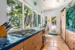 One of a kind artful kitchen area with open views looking out at ocean and coast