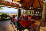 Puako Sandy Beach Villa provides a large dining table for family entertainment