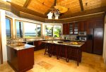 Gather around this breakfast bar in the luxury kitchen here on the Kohala Coast of Hawaii