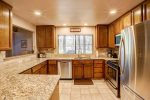 Kitchen has stainless appliances and NEW granite counters and back splash