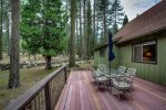 Private dining to the back of the deck with views of the forest