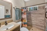 Shared guest bathroom with large custom shower