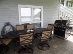Covered Patio seating with Gas Grill