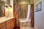 Master Bathroom with Double Vanity and Jacuzzi Tub / Shower Combo