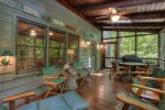 Lots of seating on screen porch and ceiling fan