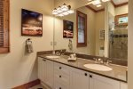 Master Bath with double sinks, and step in shower with seat