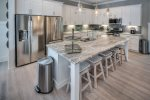 Kitchen with stainless steel appliances and bar stool seating