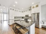 Custom kitchen with stainless steel appliances, granite counter tops and bar seating for 4