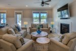 Relax in this open space living room with a large flat screen TV