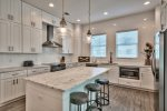 Spacious kitchen features stainless steel appliances