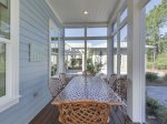 Dine outside in the screened back porch.