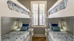 Furnished with two twin over twin bunk beds
