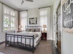 Carriage house bedroom with king bed