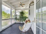 Carriage house balcony with cozy seating