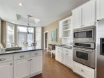 Kitchen has granite countertops and stainless steel appliances.