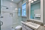 1st Floor Shared Bathroom Equipped with Walk In Shower & Single Vanity
