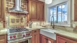 The kitchen is furnished with gas range & farm house sink