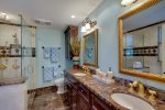 Master bath has overhead rain shower, hand held personal shower and separate shower head