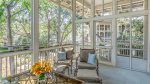 Spend your evening here on the screened in porch