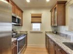 Kitchen with stainless appliances and granite countertops.