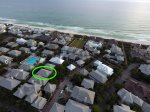 An aerial view of the home showing the Coquina Pool and proximity to the beach