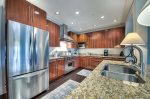 Rosemary Beach-The kitchen has a large island and granite countertops.