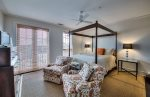 Rosemary Beach-The guest room with queen bed and large windows.