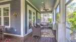 Screened-in Back Porch Offering a Cozy Porch Swing