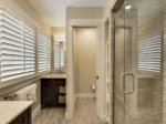 The master bathroom with double vanities and stand up shower.