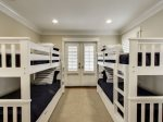 The 1st floor bunk room with 2 sets of twin bunk beds.