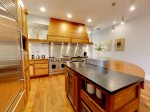 Gorgreous wood table tops and stainless steel appliances.