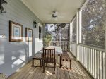Screened in back porch is perfect for dining al fresco.