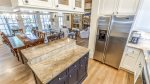 The kitchen is fit with stainless steel appliances